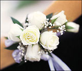 7 White Mini Roses Wristlet from Boulevard Florist Wholesale Market